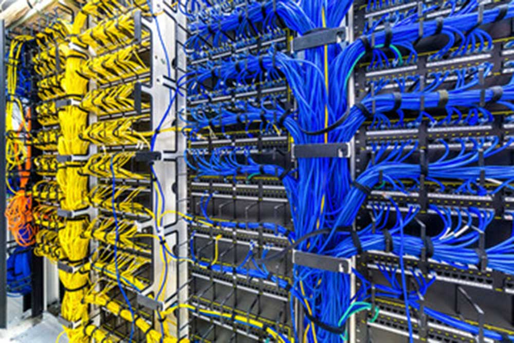 hundreds of well managed cables in data centre