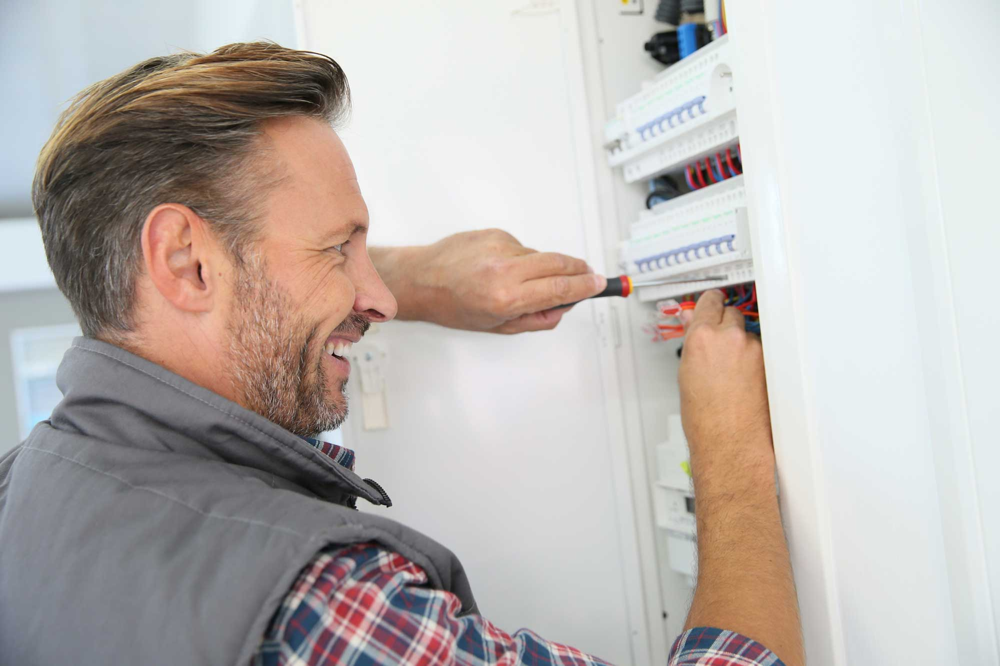 electrician testing a domestic fuseboard