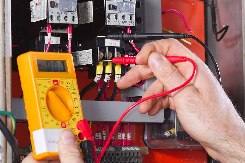 electrician  testing a fuse board